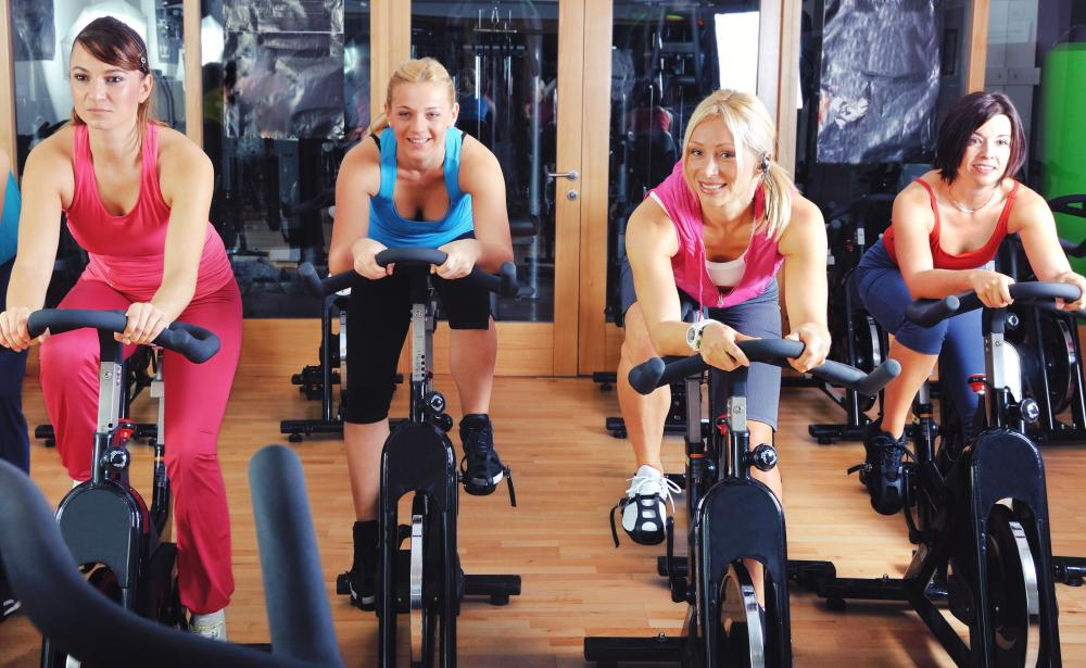 Loud music may be played during a spinning class to help keep exercisers motivated.
