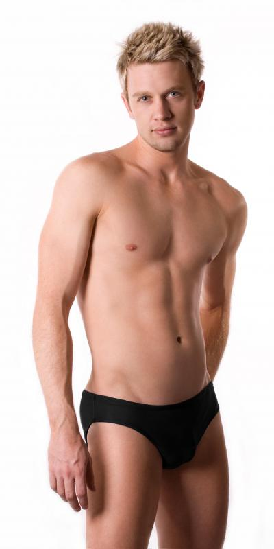 For a male, a 'swimmer's build' usually implies a flat, narrow chest.
