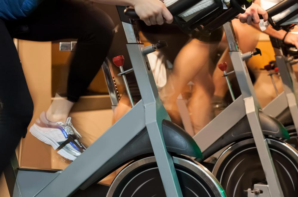 Indoor cycles are employed in spinning classes.